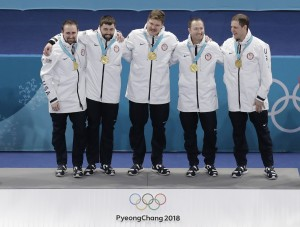 From left, United States' curling team Joe Polo, John Landsteiner Matt Hamilton, Tyler George and skip John Shuster smiles after receiving their gold medals after awarding ceremonies in their men's curling finals match against Sweden at the 2018 Winter Olympics in Gangneung, South Korea, Saturday, Feb. 24, 2018. (AP Photo/Aaron Favila) ORG XMIT: OLYCU123